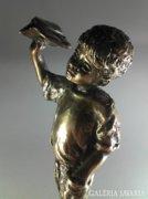 Repülős kisfiú bronz szobor