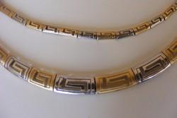 Fehér arany és arany 14 karátos nyakék és karkötő.