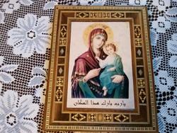 Szent kép intarziás keretben.