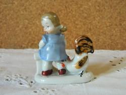W.A porcelán kislány kakassal.