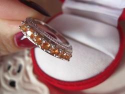 Sárga-narancsos zafír felépítményes ezüst gyűrű 7 kővel