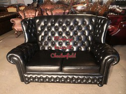 Magastámlás chesterfield valódi bőr kanapé.