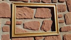 Képkeret,falc 40x60 cm,(1cm széles és 0,6cm mély),külméret 50,5x71cm,árnyalt aranyozott, modern fa
