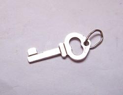 Ezüst kulcs medál.