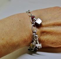 Különleges kézműves modern ezüstkarkötő