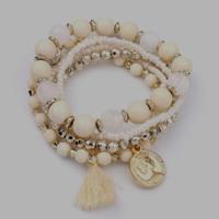 Kiárusítás! 6 részes fehér gyöngyös, arany színű sharmos karkötő