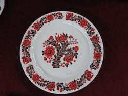 Alföldi porcelán falitányér, piros/barna mintával.