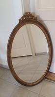 Ovális faragott-aranyozott keretű tükör