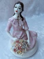 Lány rózsákkal SÉRÜLT