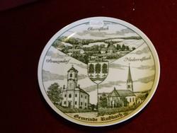 Ausztriai porcelán dísztányér, melyen három település temploma látható.