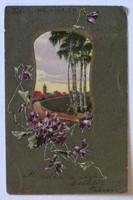 Szecessziós tavaszi üdvözlőlap 1906-ból ibolyákkal, a háttérben alkonyati tájjal, templommal
