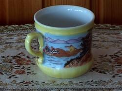 Porcelán kávés csésze, sárga alapon keleti jelenetek