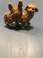 Kb 100 éves, porcelán kutya hátán, egy kakassal.