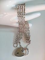Dekoratív, széles ezüst karkötő