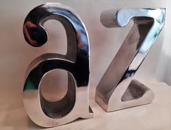 Modern polírozott alumínium öntvény design könyvtámasz pár