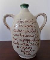 Csákvári pálinkás butella,egyik oldala írásos, másik népi virágmintás
