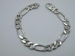KK1065 Elegáns ezüst karlánc áttetsző kövekkel figaró mintájú 925 fémjelzett vastag