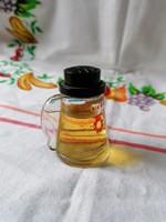 Korsó alakú mini parfümös üveg (Pacsulival töltve)