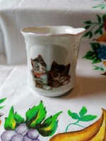 Antique cute kitten with porcelain coffee cup