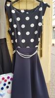 Rendkívül csinos női ruha, s méretű  teljesen jó állapotú, alkalmi viseleerű sötetkék az alapszíne