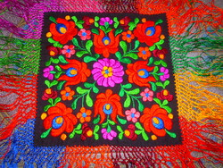 Matyo tablecloth is flawless with silk embroidery and fringing