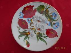 Jugoszláv porcelán, kézzel festett teáscsésze alátét, átmérője 15 cm.