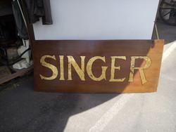 Singer tábla,régi farostlemez lapon laparanyzott betük