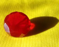 Gyönyörű kerek piros Topáz 22.85Ct tanúsítvánnyal