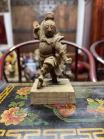 Chinese man practicing kung fu. Antique carved wooden sculpture, oriental, asian