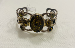Beautiful silver bracelet decorated with amber stone for sale!