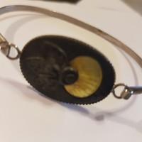 Silver plated craftsman bracelet.