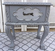 Small chest of drawers with rustic lion legs in bedside table