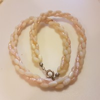 Old pearl string of pearls with silver clasp.