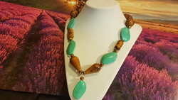 Romanian style craftsman with wooden and turquoise necklace.