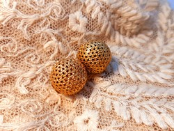 Gold colored sphere ear clip