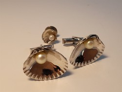 Silver shell cufflinks and buttonhole decoration