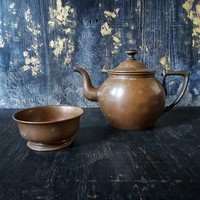 Copper teapot and cup together