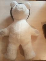 Craft teddy bear in black cap