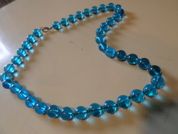 A beautiful necklace made of 51 cm blue glass beads.
