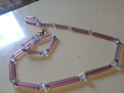 70 cm necklace made of purple, frosted glass tubes and luster crystal cubes.