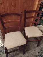 Hardwood chairs with light fabric upholstery