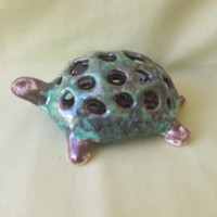 Ceramic turtle, work of applied art.