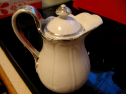 Antique shabby jug with silver border