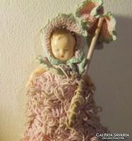 Old, retro fair toy: crochet thread, cotton body rubber doll