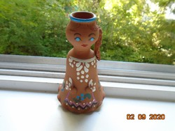 Figural painted terracotta candlestick