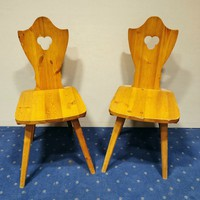 2 solid wooden armchairs. The two are 10000ft.