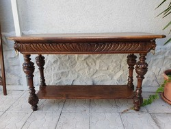 Rustic console table made of carved oak