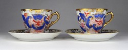 Pair of 0W721 antique marked Chinese gilded porcelain coffee cups