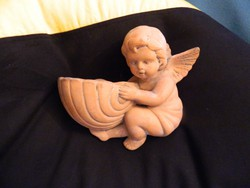 Wall brick angel - putto with sea snail