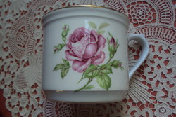 Large porcelain mug with a rose pattern and sour cream and a gold border.